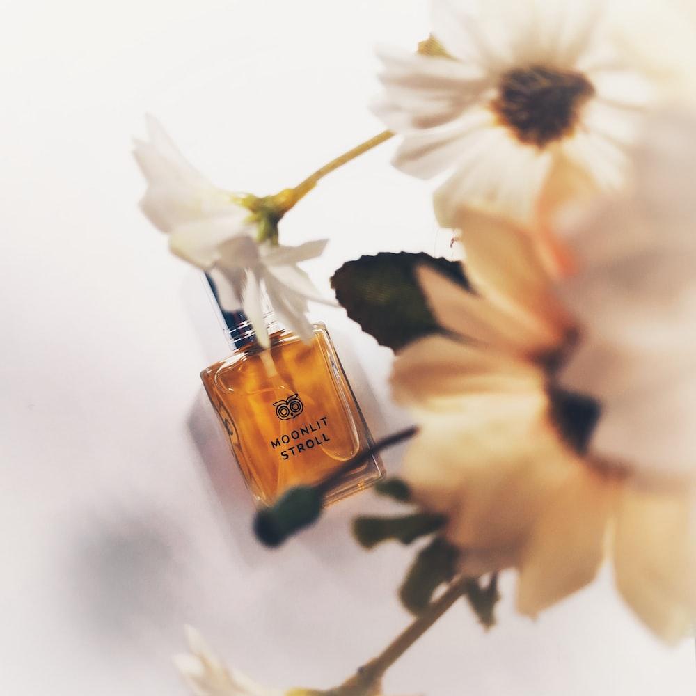 white petaled flower and Moonlit Stroll bottle