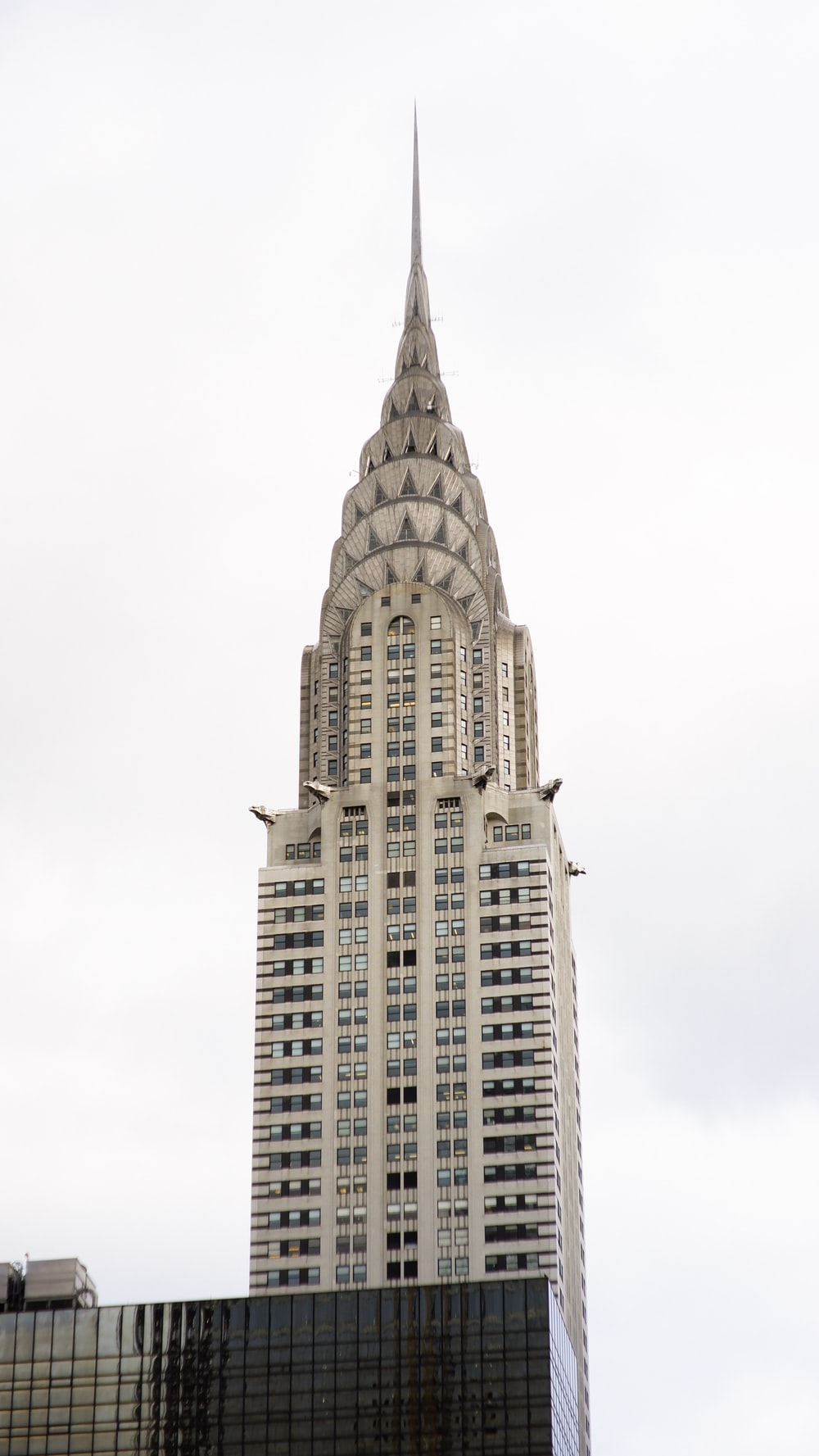 low-angle photography of white concrete building tower