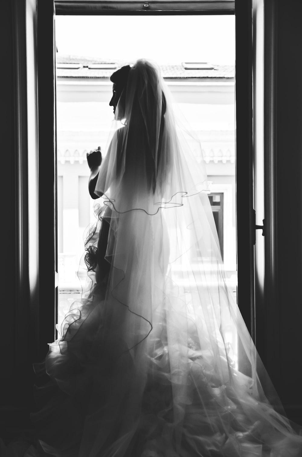 grayscale photography of woman wearing wedding dress