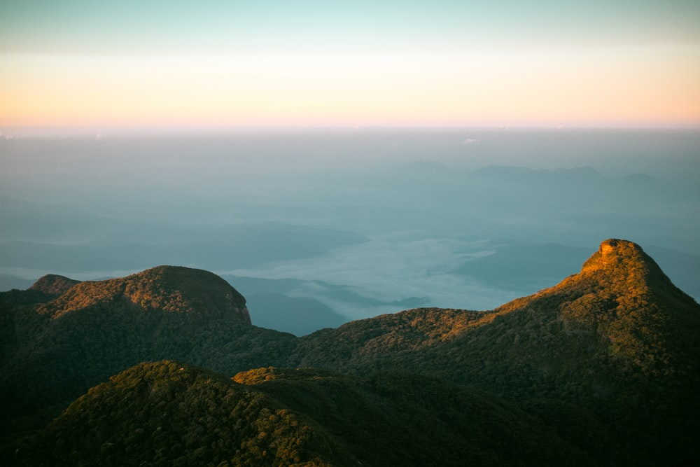 aerial view of mountain near body of water