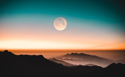mountain ranges during nighttime moon teams background