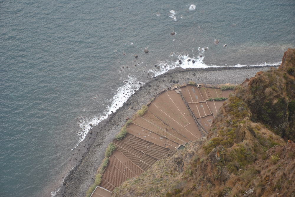 aerial photography of mountain cliff and seashore during daytime