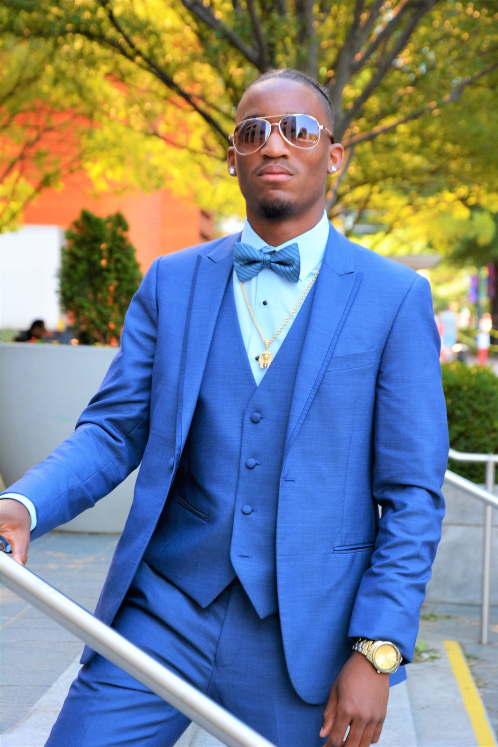 man wearing blue 2-piece suit