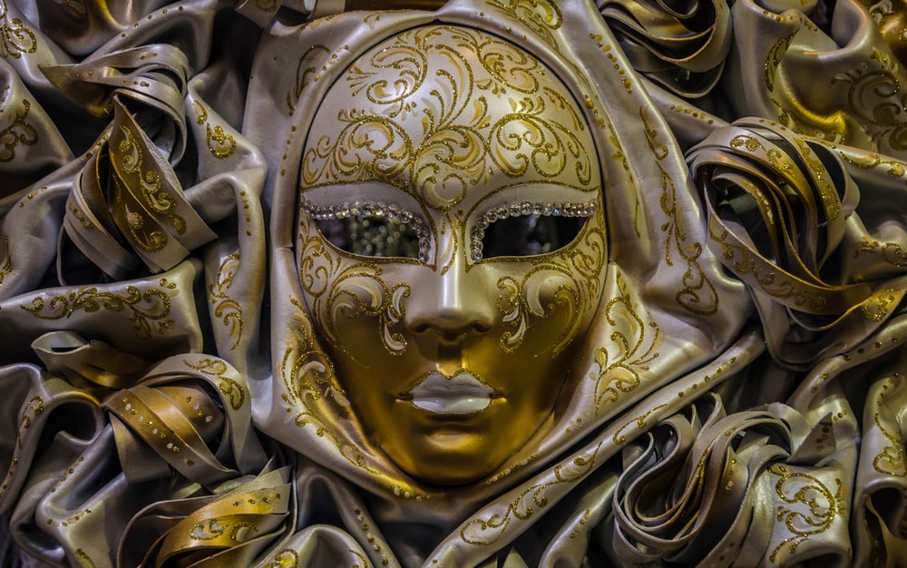 gold and white masquerade ball mask