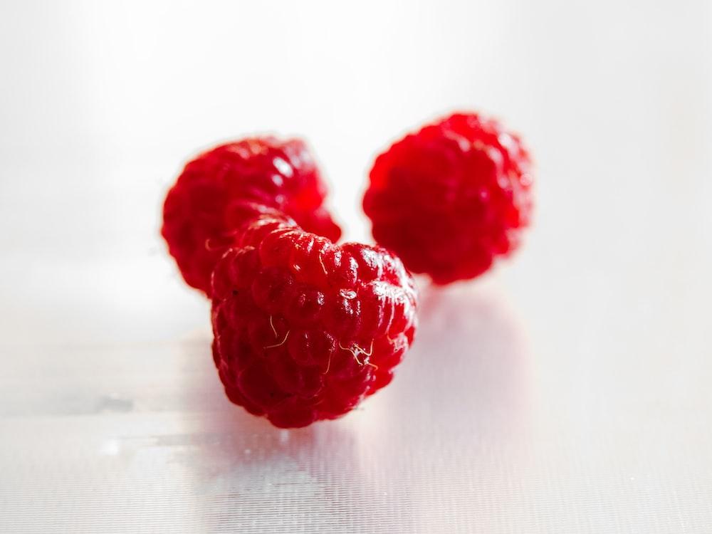 three red raspberries