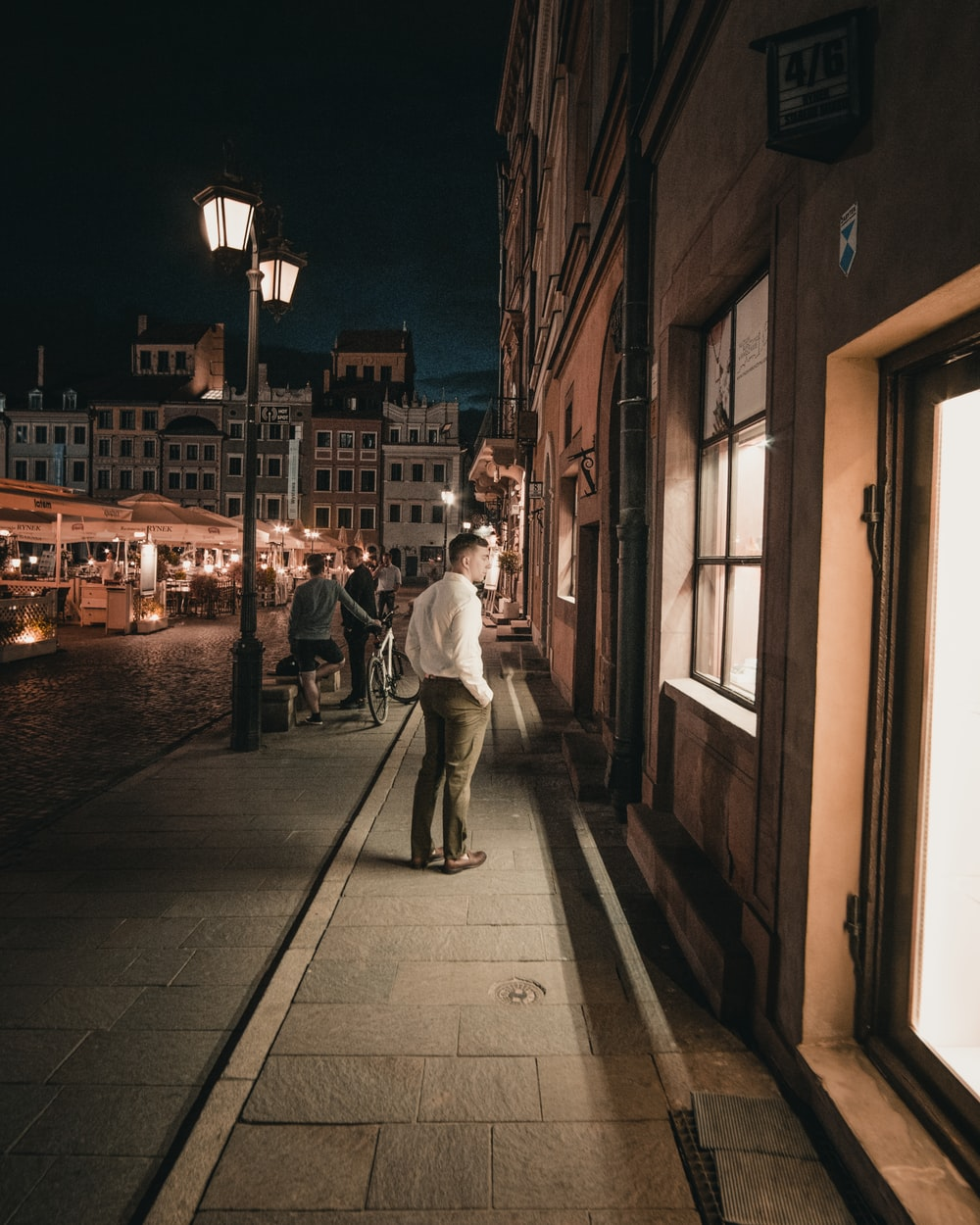 man standing and looking window