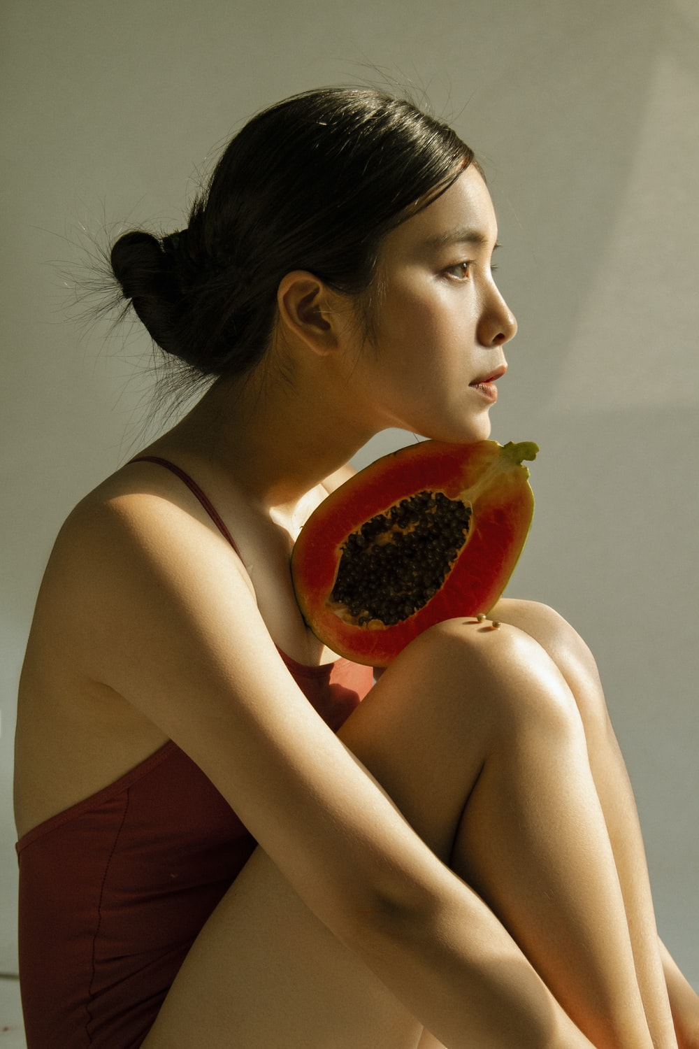 woman holding papaya fruit