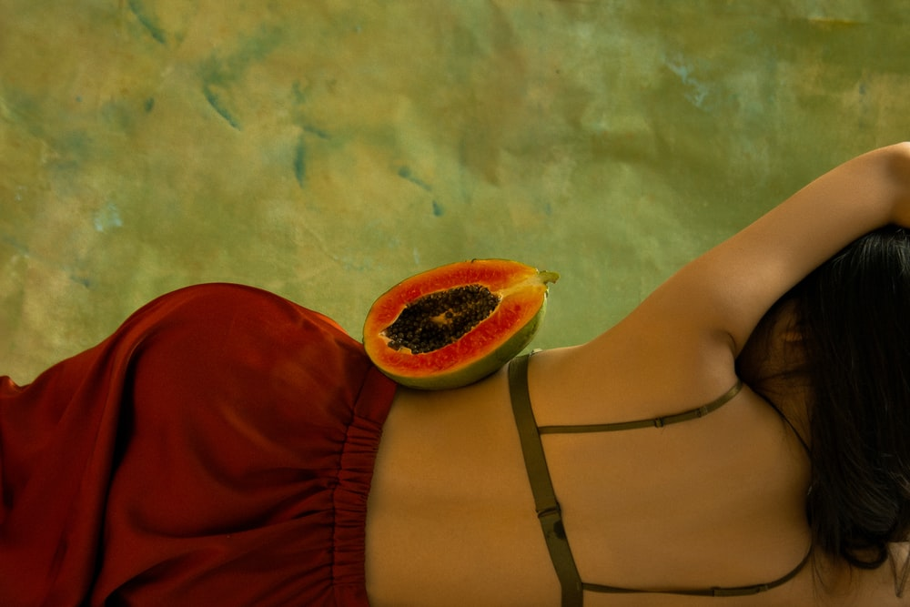 papaya fruit on woman's waist