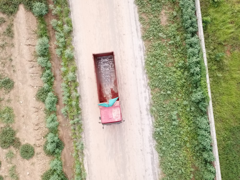 red truck on asphalt road