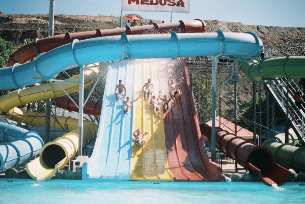 assorted-color pool slides