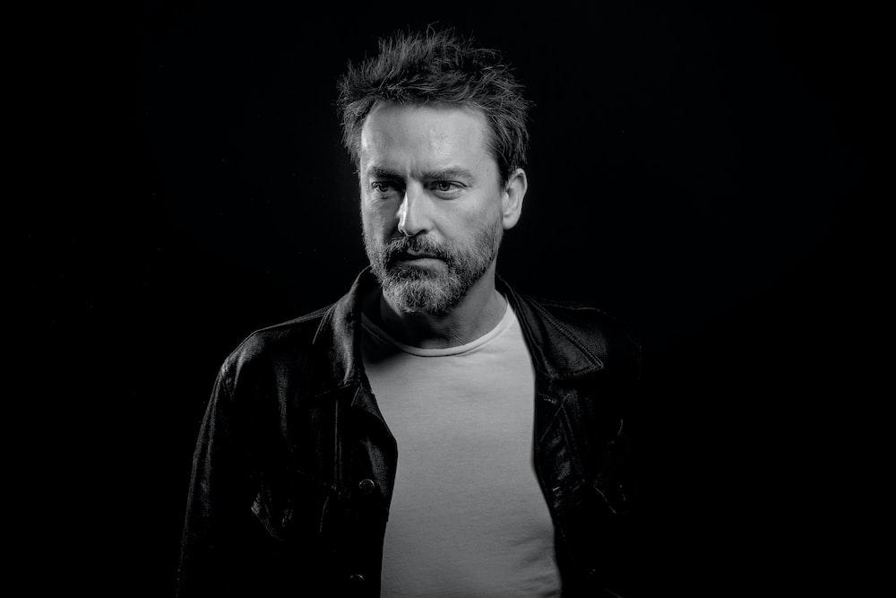 greyscale photo of man's portrait