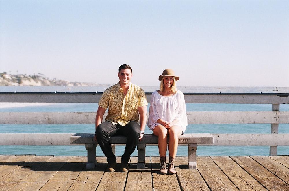 woman sitting on bench beside man