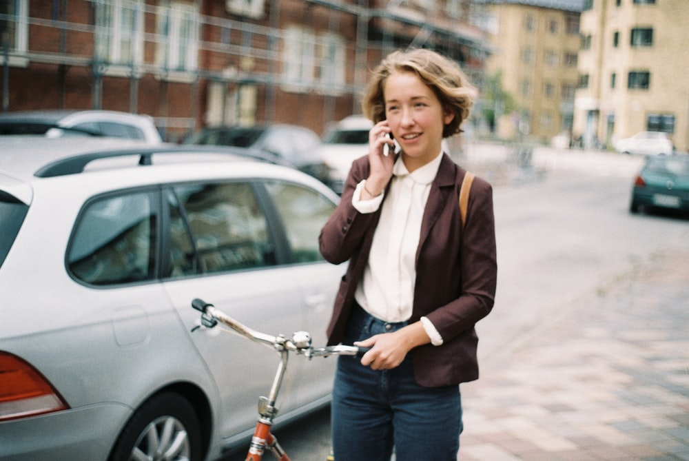 woman holding bicycle