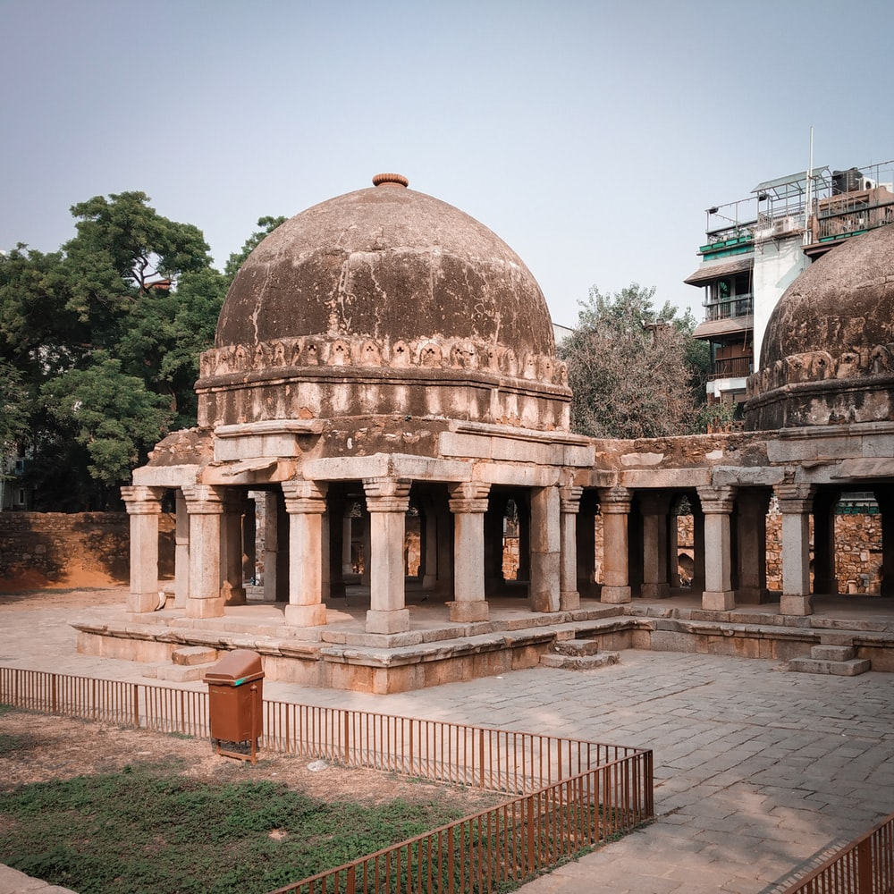 grey concrete domed building near green leafed tree