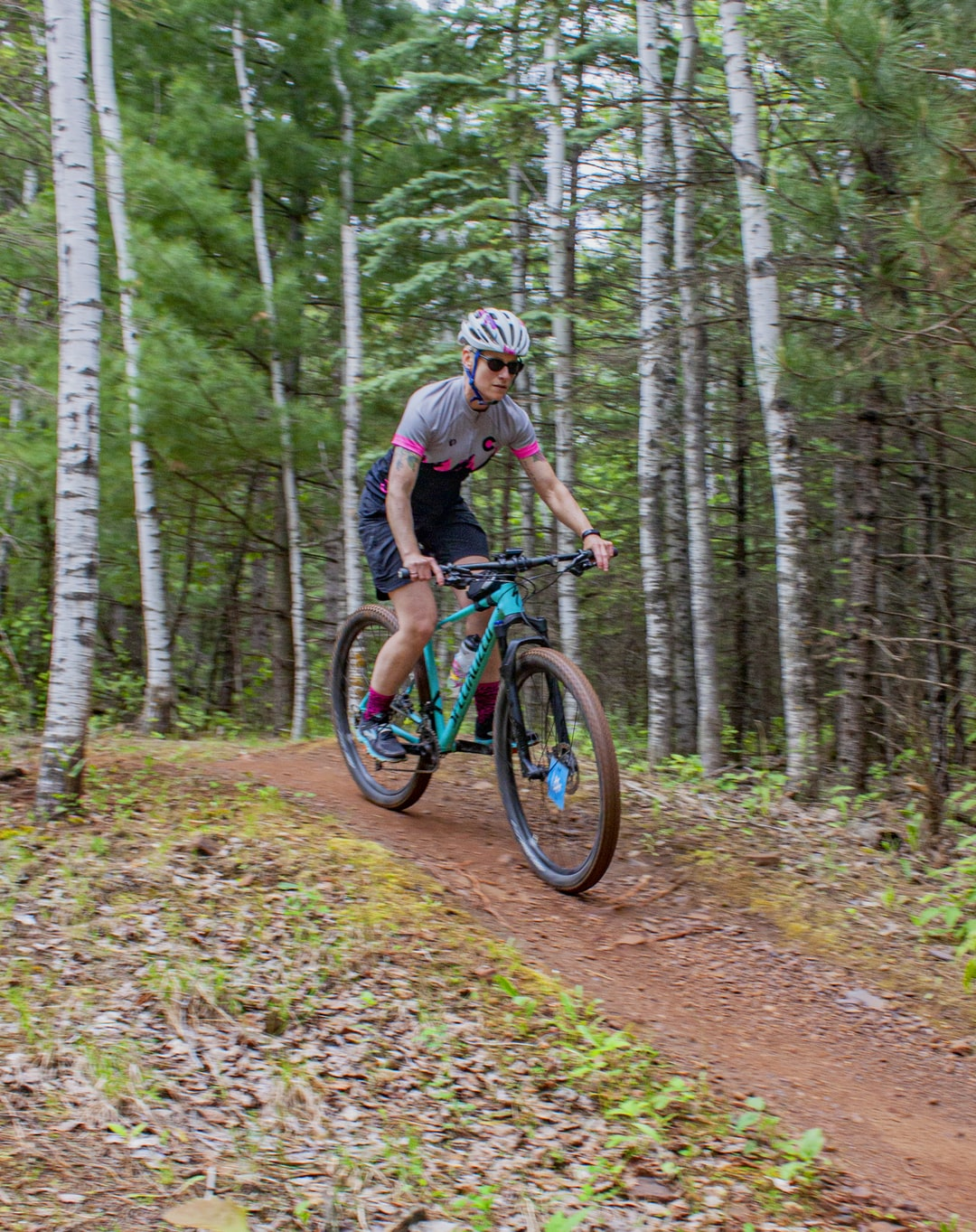 Female Mountain Biking on Trails