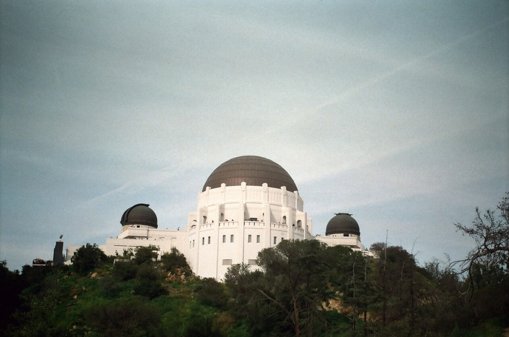 white dome building under gray sky