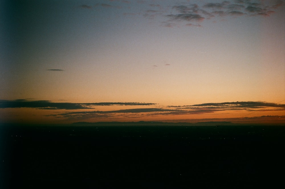 orange and gray skies