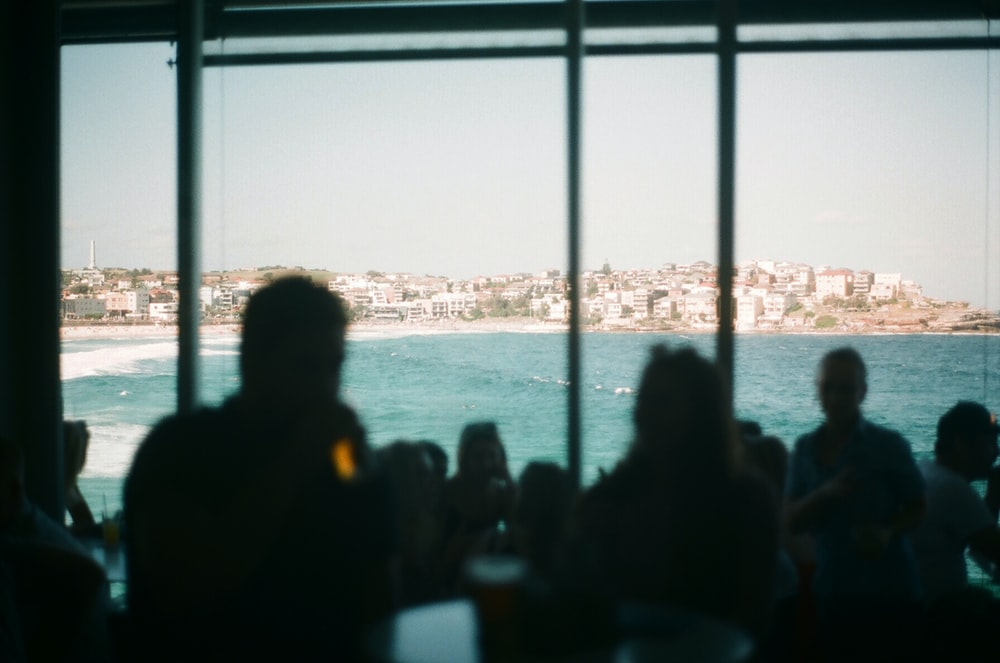 silhouette of people near glass wall