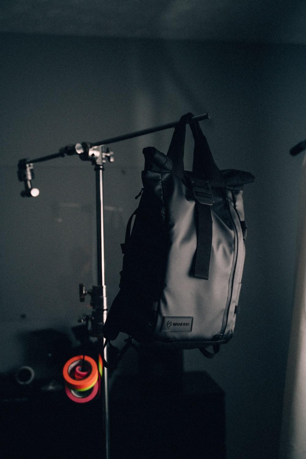 black backpack on rack