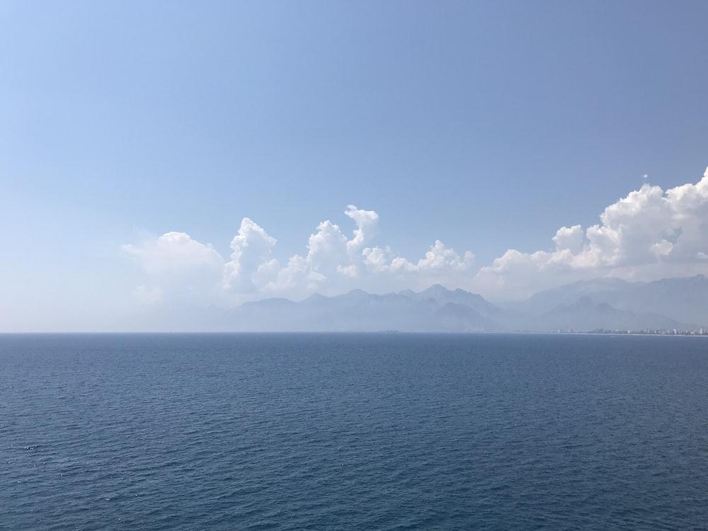 calm sea under clear blue sky