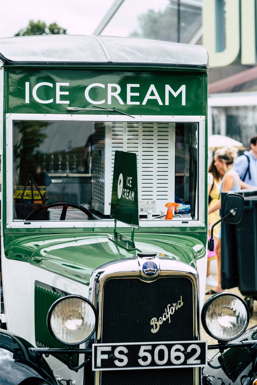 white and green Ice Cream vintage truck
