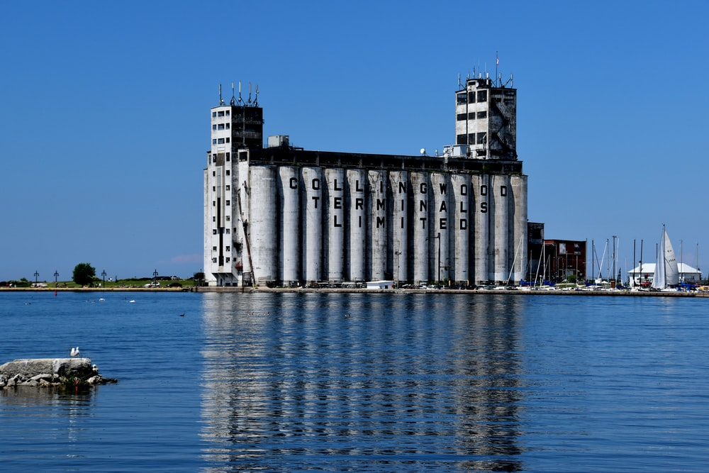 white and gray building near body of water