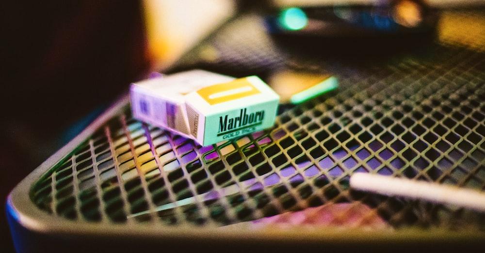 white and yellow Marlboro cigarette box