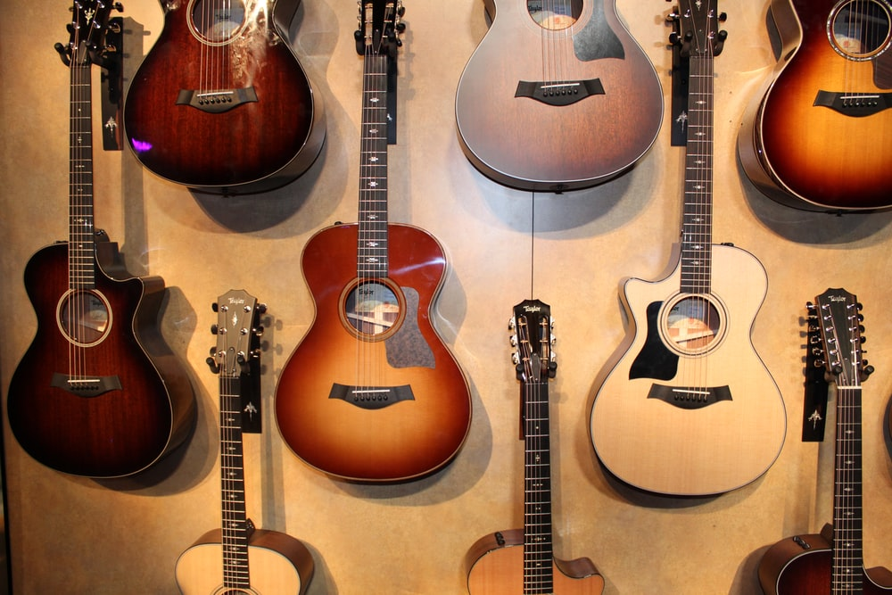 assorted-color acoustic guitars