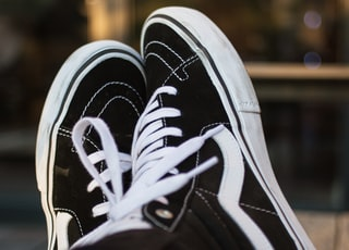 black-and-white Vans high-top sneakers