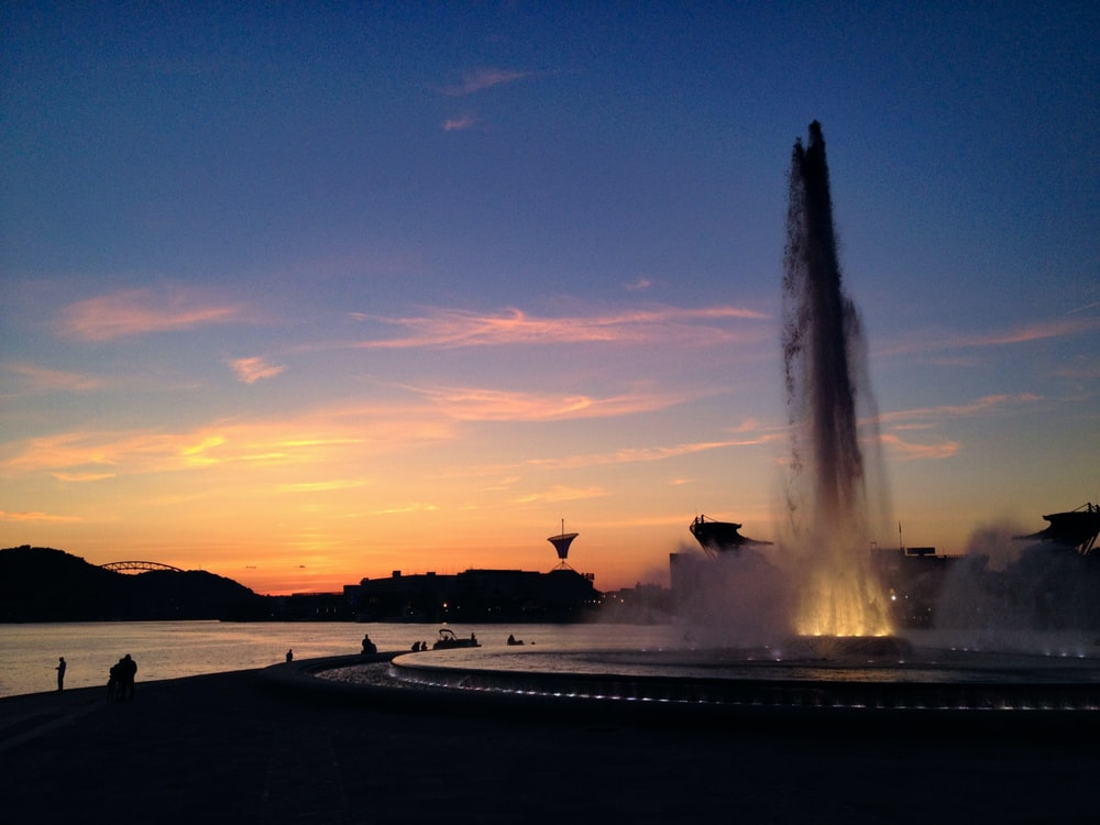 outdoor water fountain on park during sunset