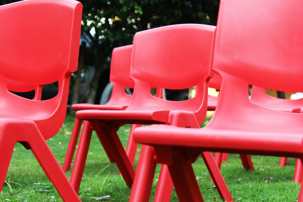 red plastic armless chair lot