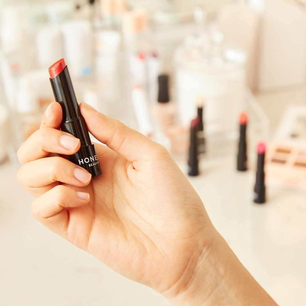 person holding lipstick
