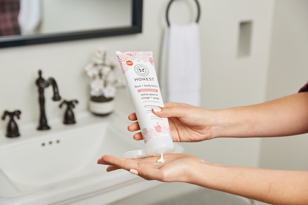 Person Squeezing Cream Out of Soft-Tube - unsplash