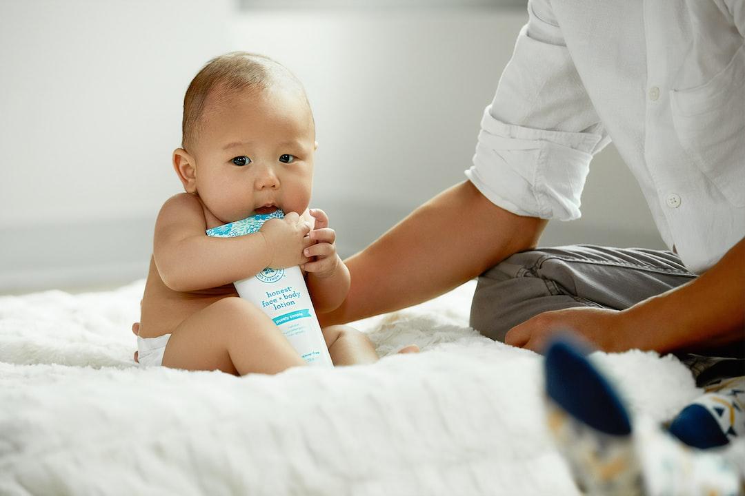 Topless Baby Hugging White Soft-Tube - unsplash