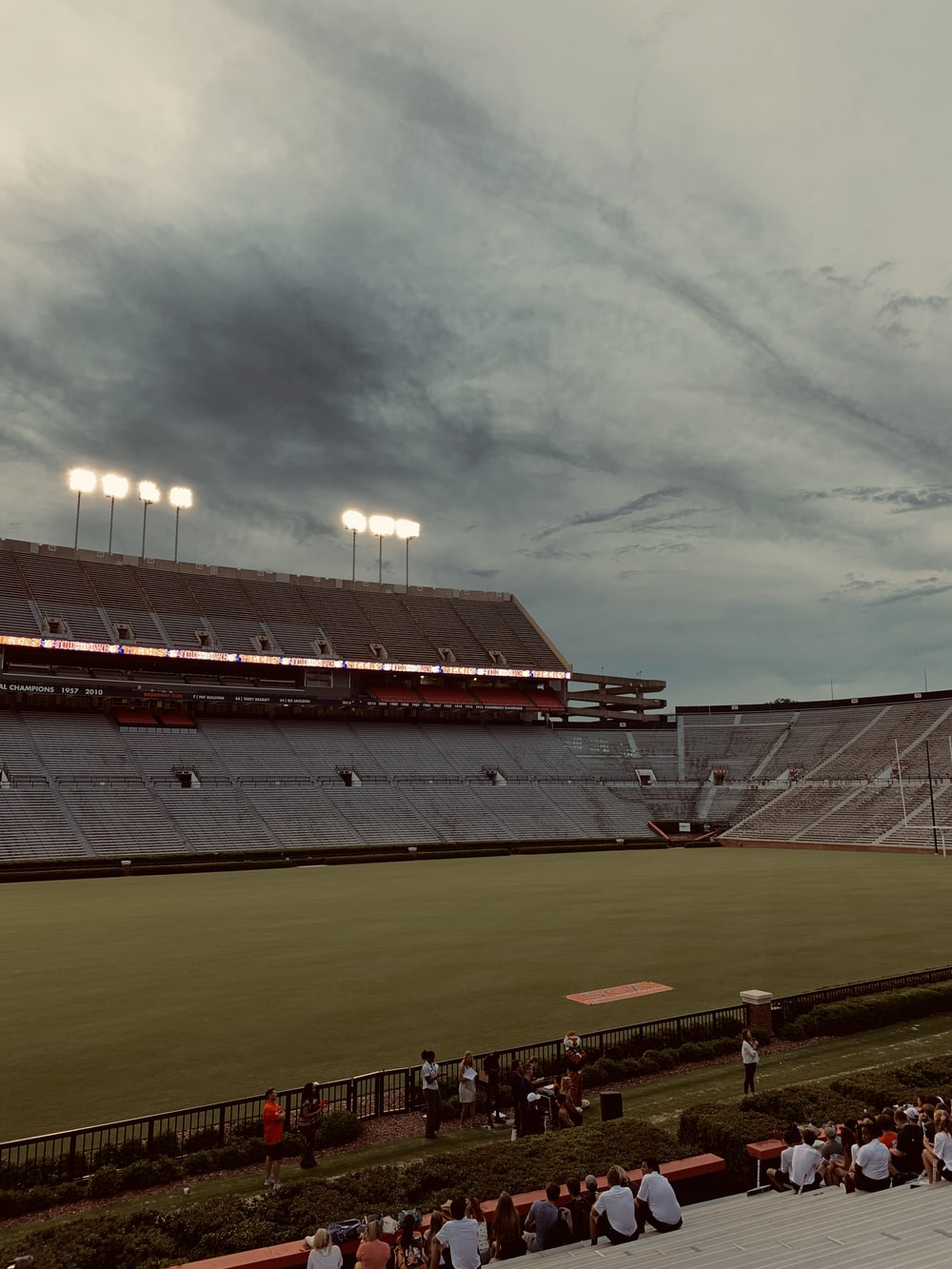 selective photography of game field under gray sky