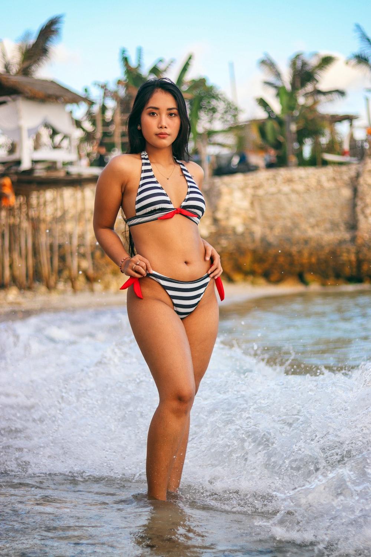 woman in black and white striped bikini on seashore