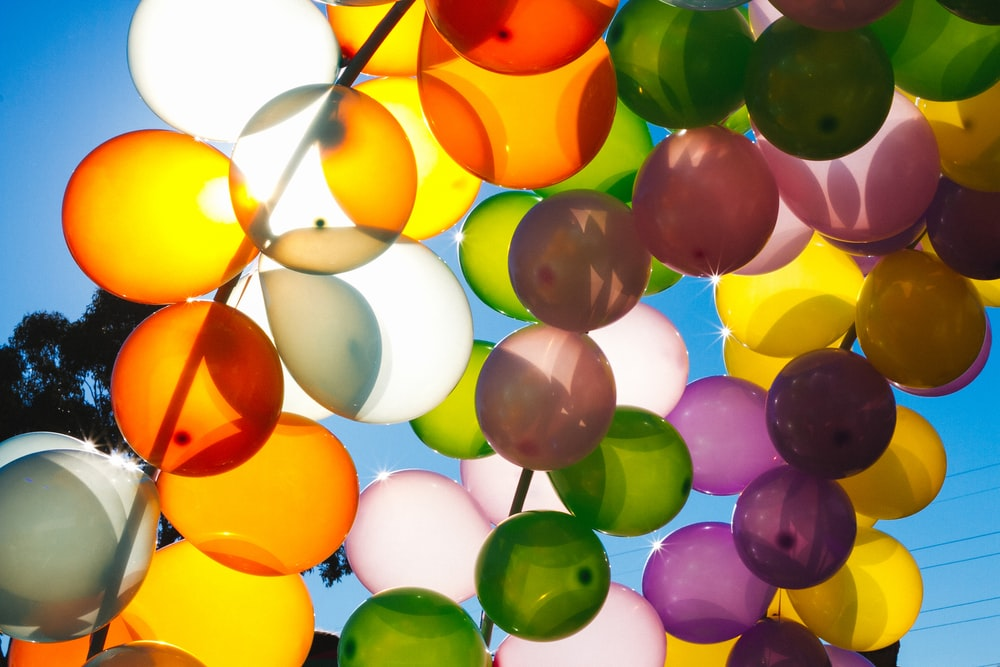 low angle photo of assorted-color balloons