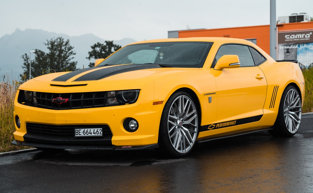 yellow Chevrolet coupe close-up photography