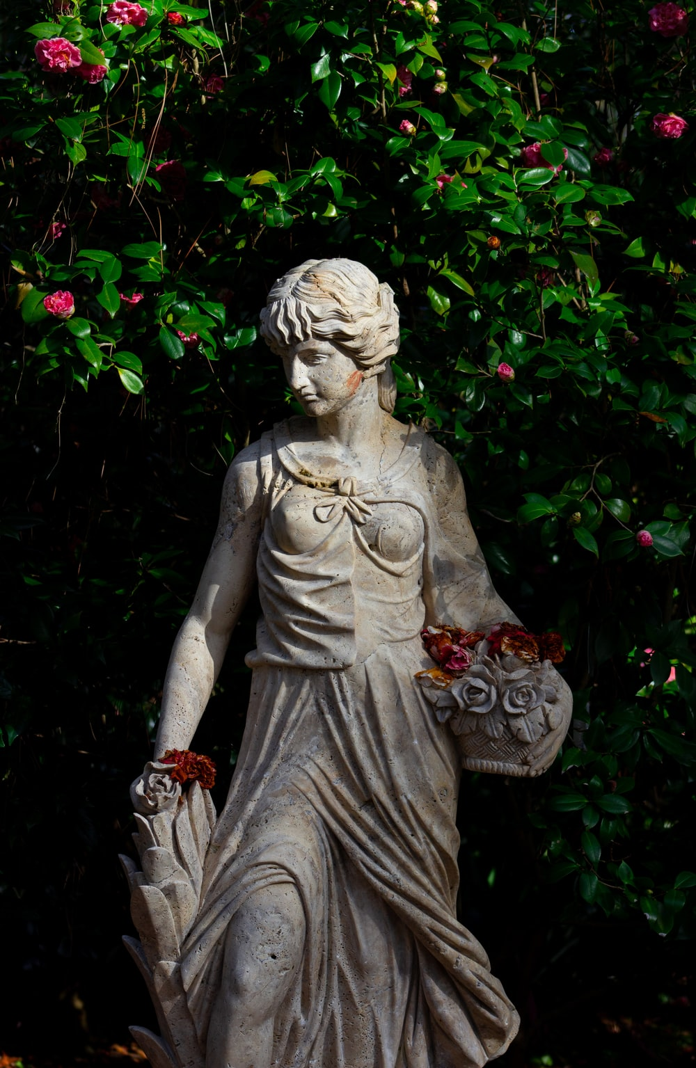woman holding basket statue