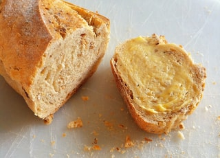 baked bread with yellow cream close-up photography