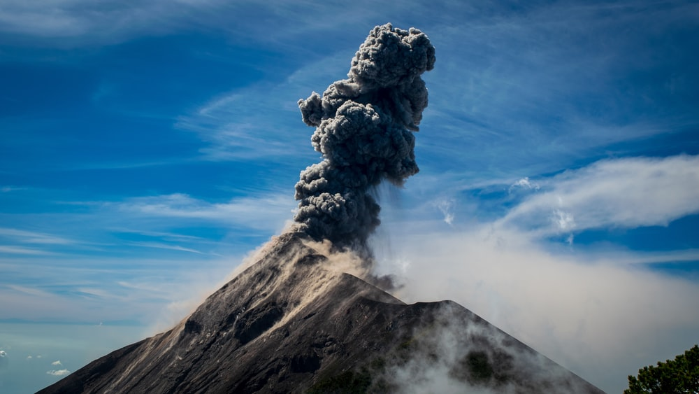 photography of volcano and black smoke during daytime