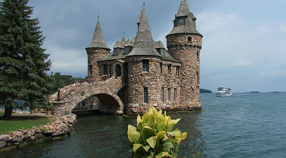 grey and brown stone castle by the sea