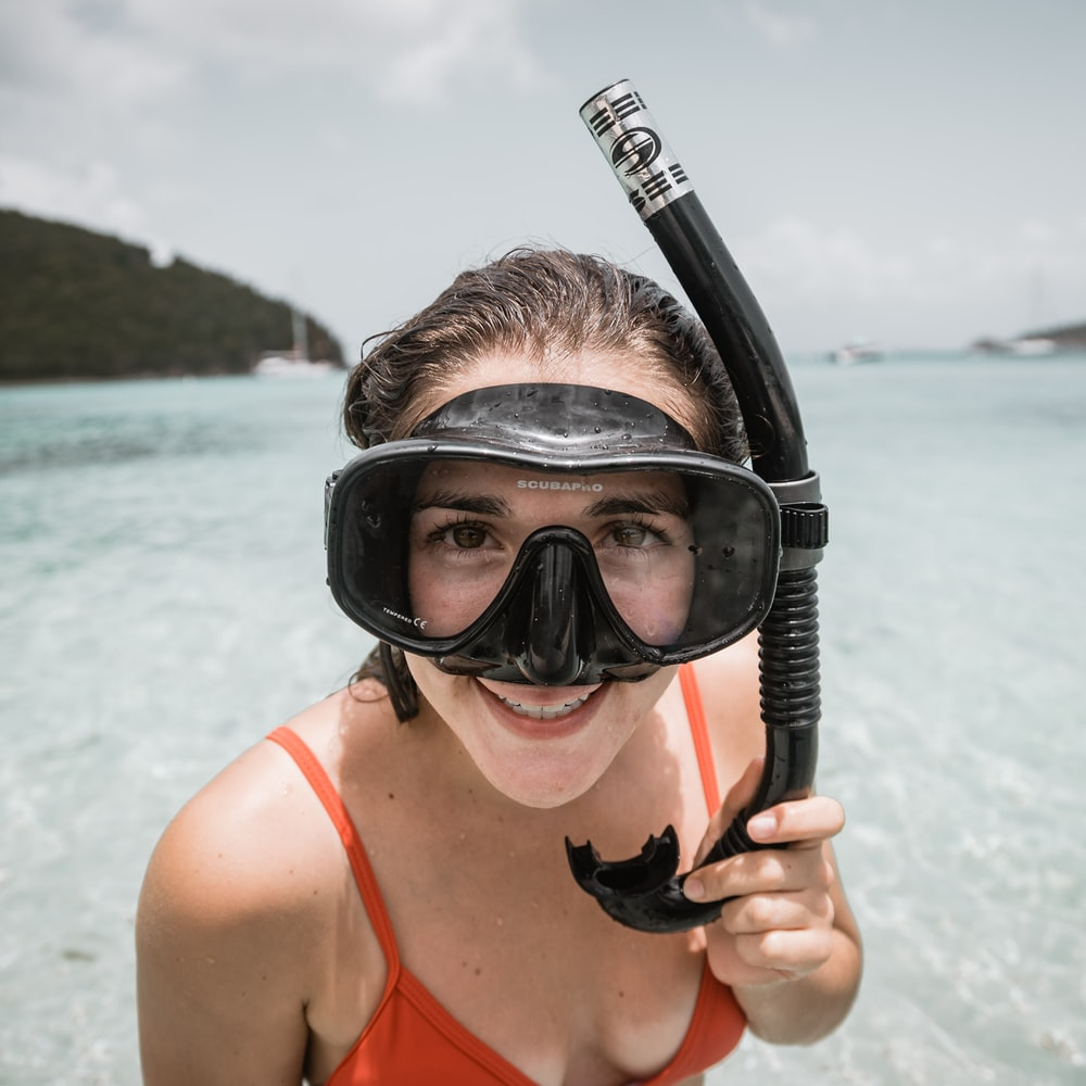 woman wearing black diving goggles and snorkel