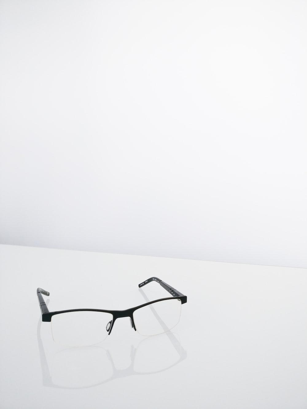 pair of black half framed eyeglasses