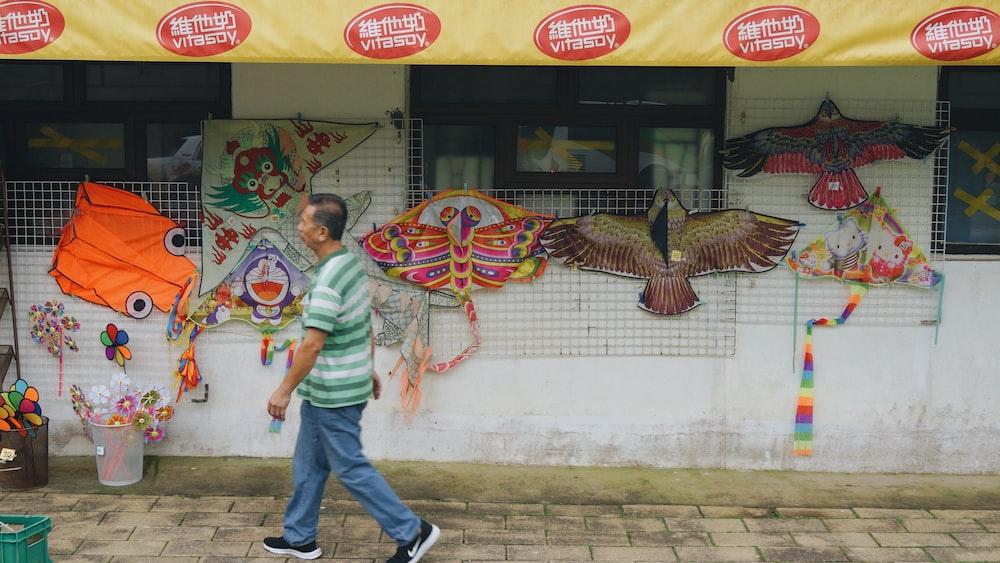 man walking beside store during daytime