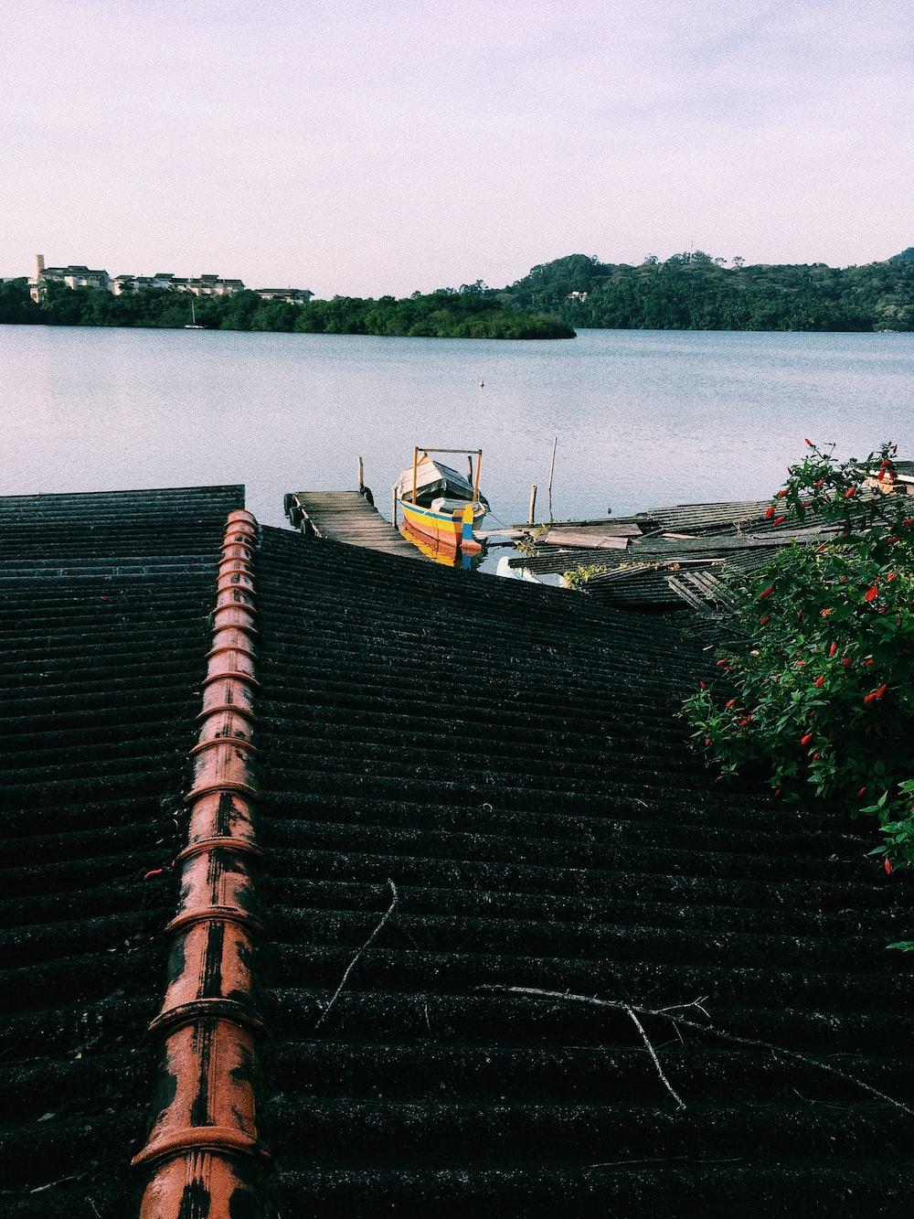 yellow canoe beside sea dock