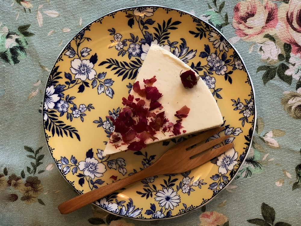 sliced cake on round yellow and blue floral plate