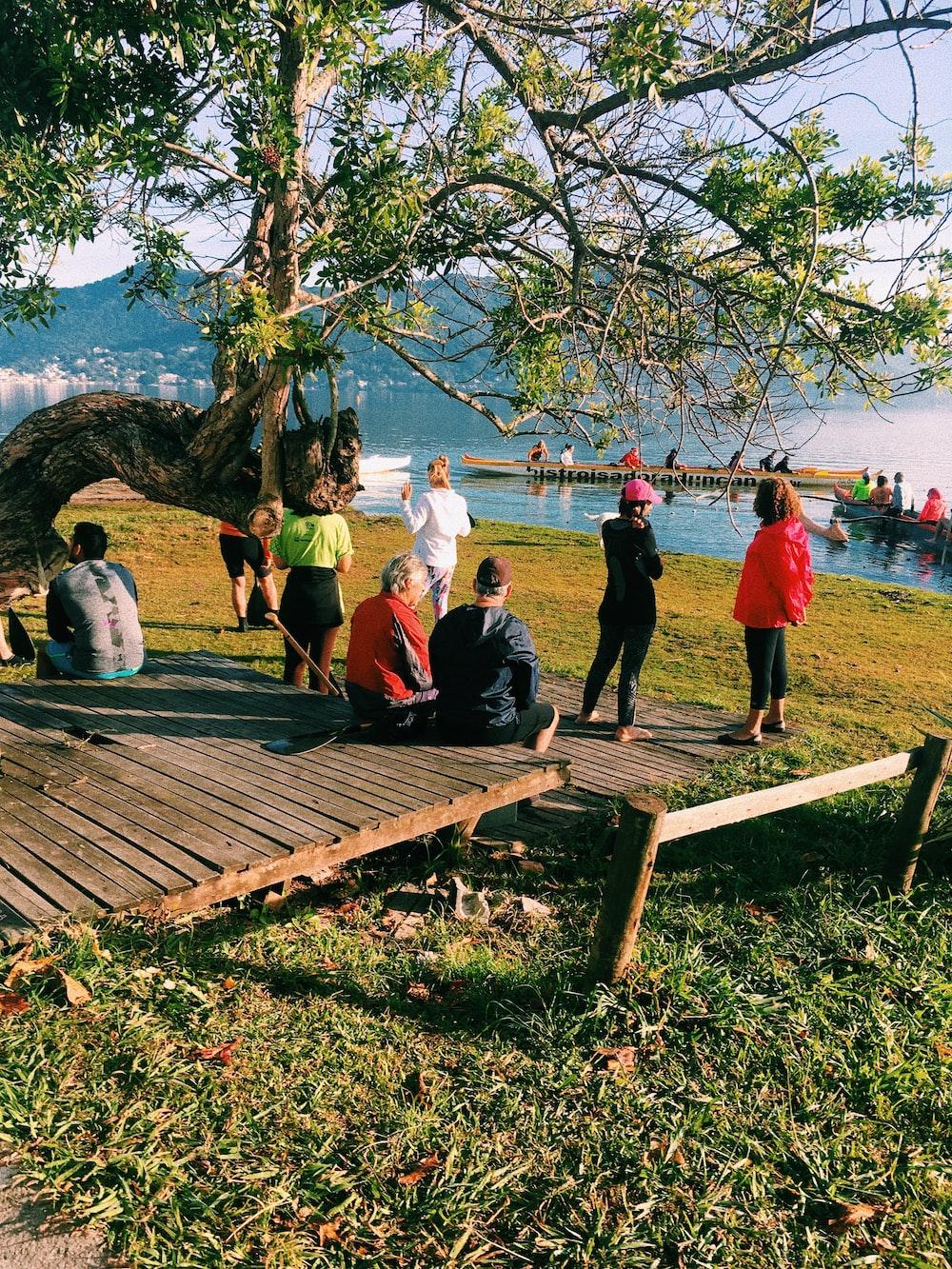 people near lake