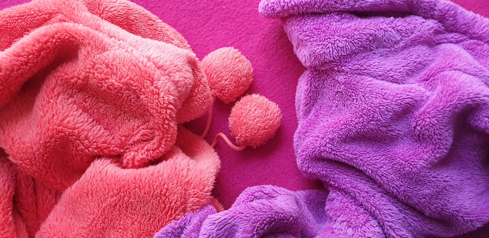 pink and purple piled textiles