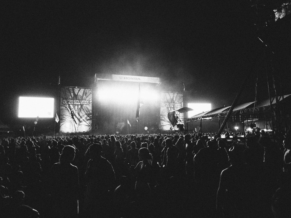 photography of people gathering near outdoor in front of stage during nighttime